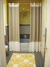 bathroom installing bathroom curtain ideas for prettier shower bathroom yellow accents wall paint for modern bathroom interior with brown curtain idea plus awesome