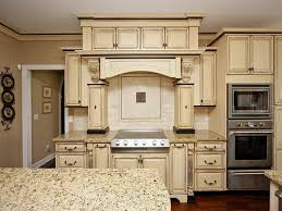 granite countertops for ivory cabinets tuscan kitchen using brown wall color and ivory distressed furniture