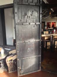 Barn Doors Houston by Pallet Wood Barn Door With Metal Rivets And Stained Black With A