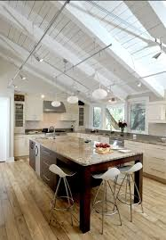 what is the best lighting for a sloped ceiling the worn floors are modern kitchen sloped
