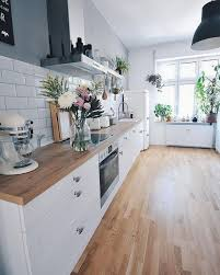 kitchen with white cabinets and wood countertops 71 cozy wooden kitchen countertop designs digsdigs