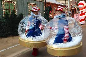 christmas light parade floats inflatable snow globe costumes are a hit at rudolph s holly jolly