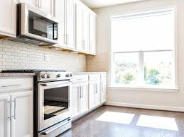 how to cut tile around cabinets 4 inexpensive options for kitchen flooring options