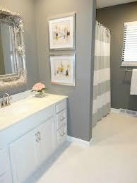 cheap bathroom ideas white toilet on the black ceramic tile floor