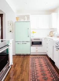 new yorker kitchen cabinets a new yorker transforms an 1890s michigan house big chill fridge