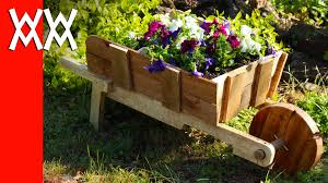 make a rustic wheelbarrow garden planter easy diy weekend project