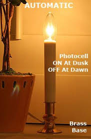 electric candle lights for windows this electric window candle light features a lacquered brass finish