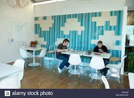 skype headquarters employees in a cafeteria at the skype worldwide headquarters stock