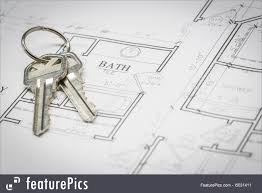 image of set of new house keys resting on house plans