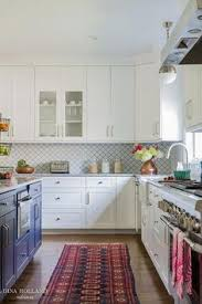 Arabesque Backsplash Tile by White Kitchen Cabinets Are Finished With A White Marble Countertop