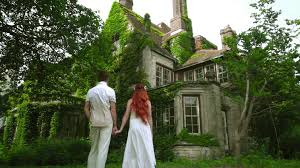 honeymoon couple looking at beautiful country house fairytale