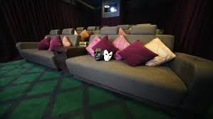 Sofa Movie Theater by Black And White Theatrical Masks On Soft Sofa In Movie Theater