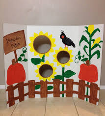 diy fall festival bean bag toss game by painting a trifold display