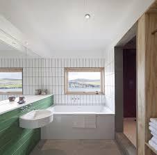 White And Green Bathroom - serene residence on isle of skye blends rural and modern aesthetics