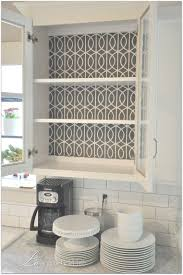paint or wallpaper use fabric for the backing of shelves instead of paint or