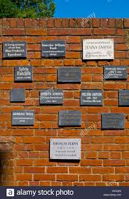 memorial plaques memorial plaques on a brick wall at rufford ollerton in stock