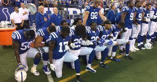 nfl anthem colts browns kneel lock arms after trump u0027s comments