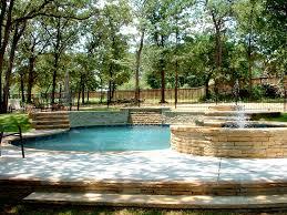 natural swimming pool drystack stone veneer waterfall keller