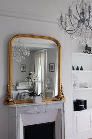 parisian decor gold mirror marble fireplace u2014 bows u0026 sequins