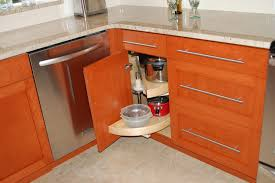 upper corner kitchen cabinets beadboard wall electric cooktop corner cabinets storages many snack wooden knife open