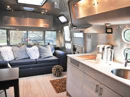 luxury airstream trailer interior with comfortable leather sofa