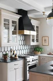 white and taupe lower kitchen cabinets black and white geometric tiles with light taupe cabinets