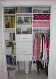 simple white wooden drawers and open shelves as well closets for