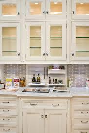 Grey Beige Tile Backsplash And White Cream Wooden Kitchen Cabinet