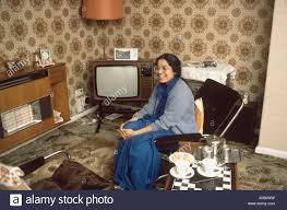 typical 1970 interior of asian woman in english home stock photo