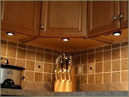 low voltage cabinet lighting low voltage under counter puck lights fooru me