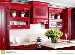 modern red kitchen with stylish furniture stock photo image