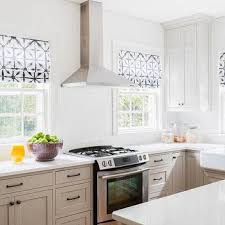 camouflaged kitchen hood tiled in subway tiles transitional