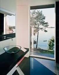 scandinavian bathroom design with view of the beach