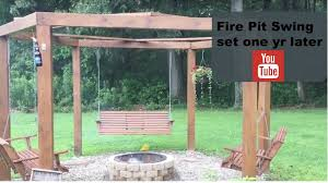 swing pergola fire pit swing a year later youtube