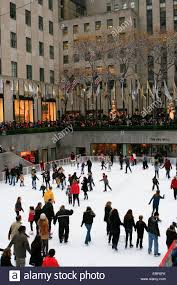 visitors and ice skaters enjoy the rockefeller center ice skating