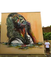 Mural Artist by A Beautiful Woman Poses Eternally In This Large Street Art Mural