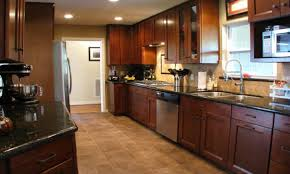 dark wood tile flooring bar island kitchen quartz countertop
