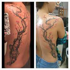 cherry blossom tree with tiger side tattoos