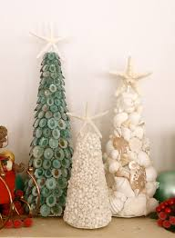 set of 3 seashell trees surround with some ornaments and berries and
