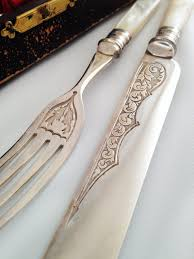 exquisite mother of pearl and silver knives and forks early