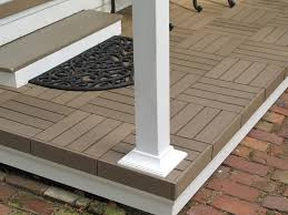 floor composite deck tiles with white pillars and gravel plus