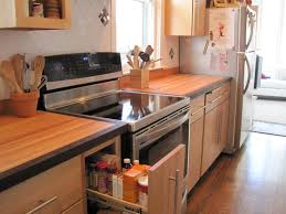 natural maple cabs with red oak floors the countertops are maple butcherblock with black walnut edging all my friends and family comment that the kitchen looks so warm and inviting now it used