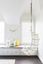 white cottage teen room with white hanging rattan chair
