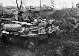 volkswagen schwimmwagen german soldiers riding in a