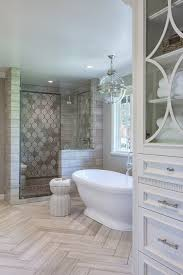 master bathroom tile designs master bathroom with herringbone tile on floor freestanding tub