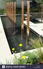 a new small garden water feature using welsh slate rocks stock