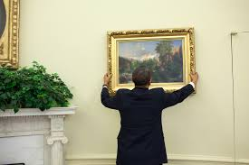 file barack obama straightens a painting in the oval office may