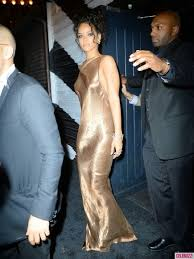 rihanna flashes in backless gold dress at met gala