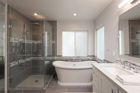 bathroom tile trends for your remodel angie s list bathroom tile design on floor and shower with glass tile