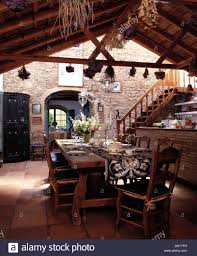 rustic wooden table and chairs in dining area of large spanish